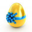 Easter surprise - golden egg with ribbon isolated on white — Stock Photo #4909515
