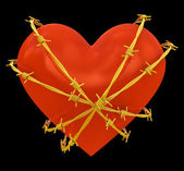 Heart shape wrapped with golden barbed wire isolated on black — Stock Photo