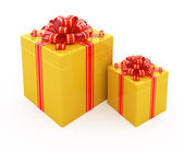 Gift box with golden ribbon isolated on white — Stock Photo