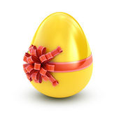 白で隔離されるリボンと黄金の卵 — ストック写真