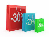 Shopping Discount concept. Red bags isolated on white — Stock Photo