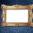Gold frame on victorian or regency style wallpaper - Stock Photo