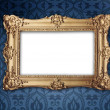 Gold frame on victorian or regency style wallpaper — Stockfoto