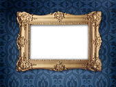 Gold frame on victorian or regency style wallpaper — Stock Photo