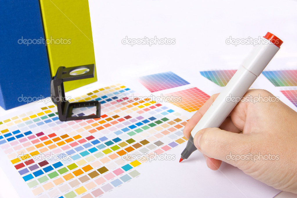 Graphic designer, printer or ilustrator with colour swatches  Lizenzfreies Foto #4452623