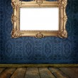 Gold frame hanging on a wall in old gallery — Stock Photo