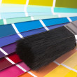 Paint swatches and paintbrush close up — Stock Photo