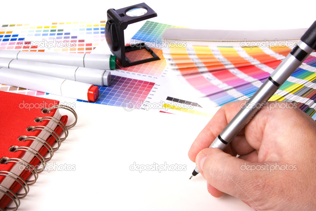 Graphic design and coloured swatches and pens on a desk — Stock Photo #4630804