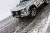 Car skidding on an icy road — Stockfoto