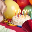 Child blowing candles out — 图库照片