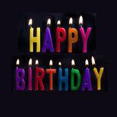 HAPPY BIRTHDAY CANDLES ON BLACK BACKGROUND — Stock Photo