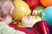 Child blowing candles out — Stock Photo