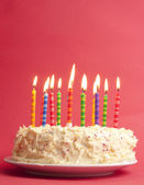 Birthday cake on red background — Stockfoto