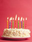 Birthday cake on red background — Stock Photo
