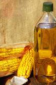 Yellow corn and oil. — Stock Photo
