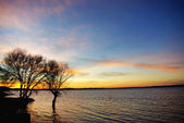 Sunset in the lake Alqueva. — Stock Photo