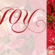 Christmas poinsettias with joy word — Stock Photo