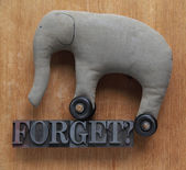 Forget word with old elephant toy — Stock Photo