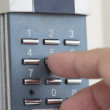 Opening the door with number combination — Stock Photo