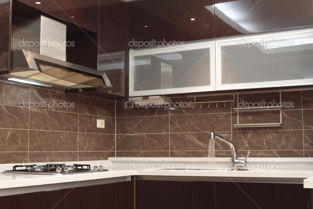 Modern kitchen with details, sink, hood, burner, faucet and cabinets. — Stock Photo #5173337