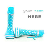 Cyan rubber boots — Stock Photo