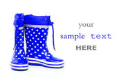 Blue rubber boots — Stock Photo