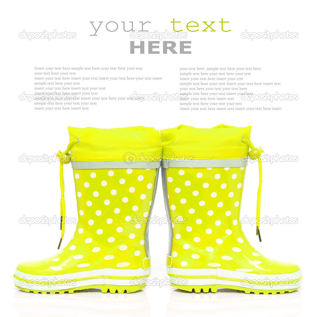 Yellow rubber boots for kids isolated on white background (with sample text) — Stock Photo #4568821