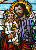 Saint Joseph holding baby Jesus — Stock Photo