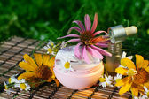 Cream and oil with flowers — Stock Photo