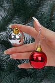 Hand holding Christmas balls — Stock Photo