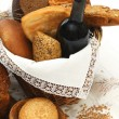 Bread products and wine in basket — Stock Photo