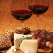 Red wine,  grapes and cheese - Stock Photo