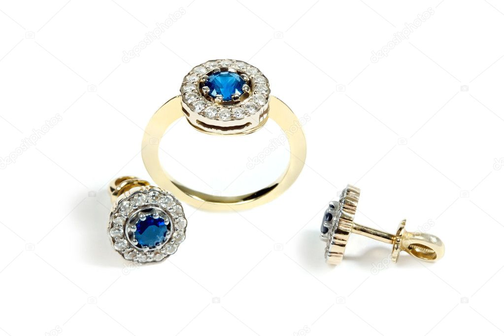 The ring and earrings with sapphires and  diamonds. Isolated on white  background  Stock Photo #4352914