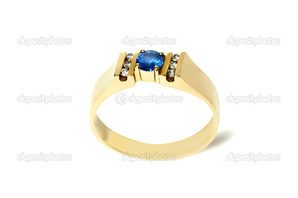The ring with sapphire and diamonds  isolated on white a background.  Stock Photo #4389983