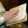 Bible in priest's hands — Stock Photo
