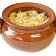 Sauerkraut in a clay pot — Stock Photo