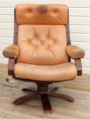 Worn leather recliner chair — Stock Photo