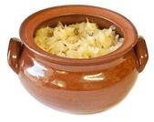 Sauerkraut in a clay pot — Stock Photo