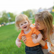 Happy mother and her little son outdoors session — Stock Photo