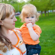 Stock Photo: Happy mother and her little son outdoors session