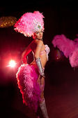 Cabaret dancer over dark background — Stock Photo
