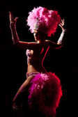 Cabaret dancer over dark background — Stock Photo