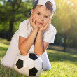 Cute little boy with a ball in beautiful park in nature; — Stock fotografie