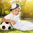 Cute little boy with a ball in beautiful park in nature; — Stok fotoğraf