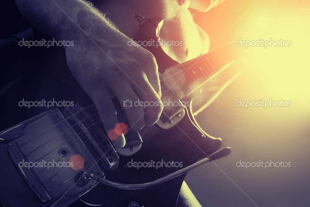 Man playing electrical guitar in black and yellow — Stock Photo #4868838