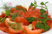 Salad with fresh tomatoes and cucumbers — Stock Photo