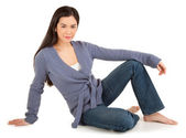 Beautiful Casually Dressed Lady Sitting on Floor Isolated on Wh — Stock Photo