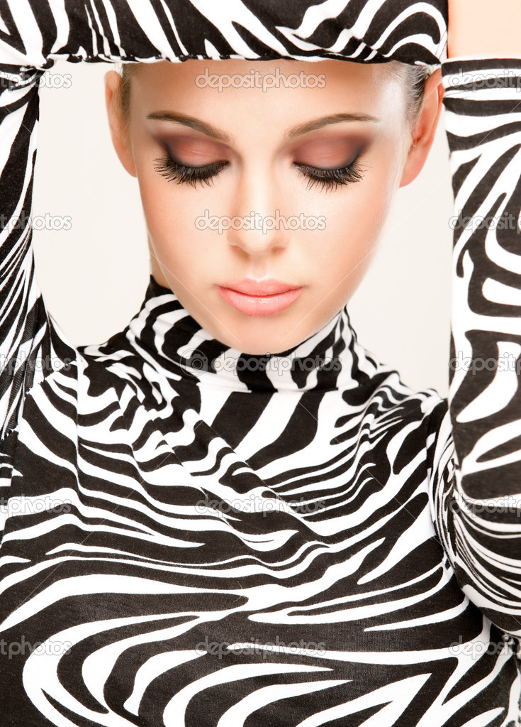 Gorgeous young woman posing in zebra pattern outfit  Stock Photo #4557618