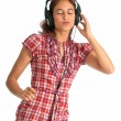 Stock Photo: Swaying to music with headphones on