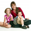 Pretty young mother with her two children — Stock Photo